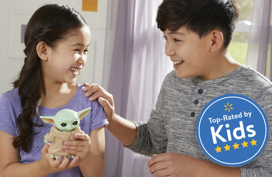 Children playing with Baby Yoda Bop It toy
