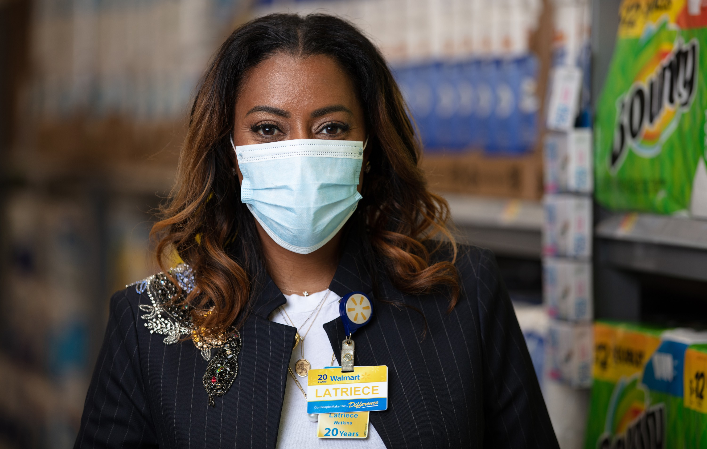 Latriece Watkins, executive vice president of consumables, wears a mask inside a Walmart store