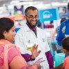 Walmart Pharmacy Manager Interacts with a Child