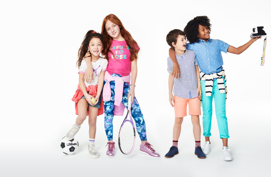 Children posing while wearing clothing from KIDBOX