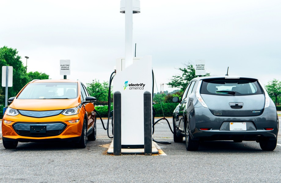 Two electronic cars at EV charging stations