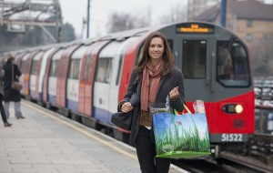 ASDA Click and Collect customer with reusable shopping bag walks away from a train station