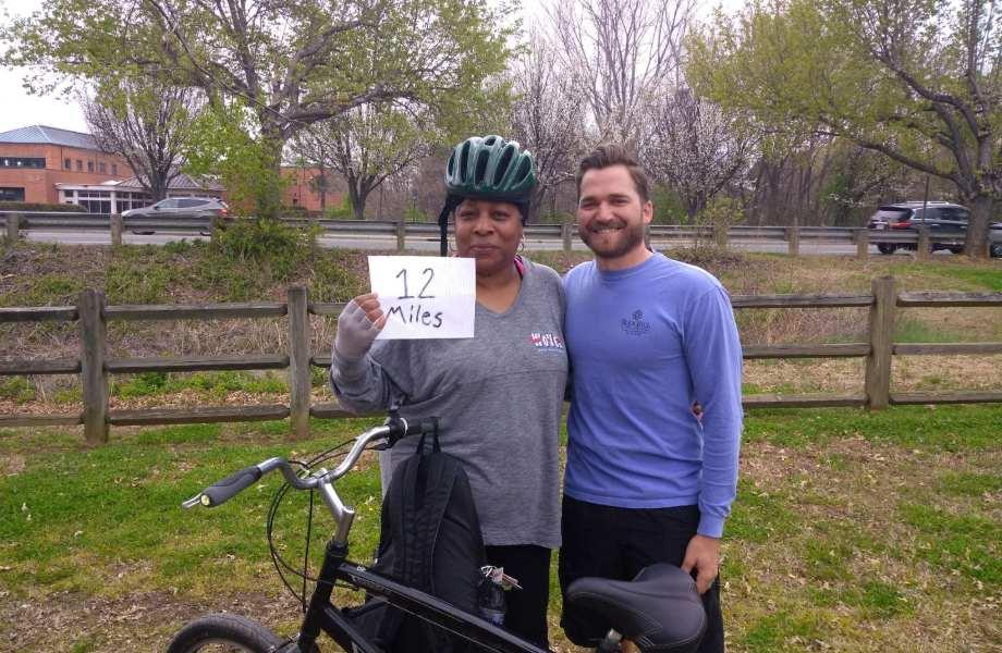 U.S. Marine Corps veteran Tina Brice stands next to a bicycle