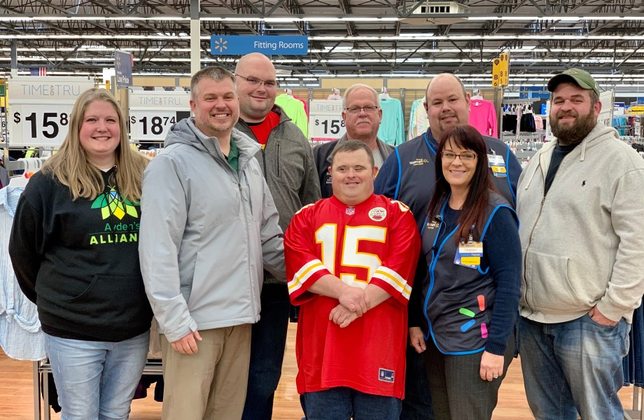 Dustin and family standing in Walmart