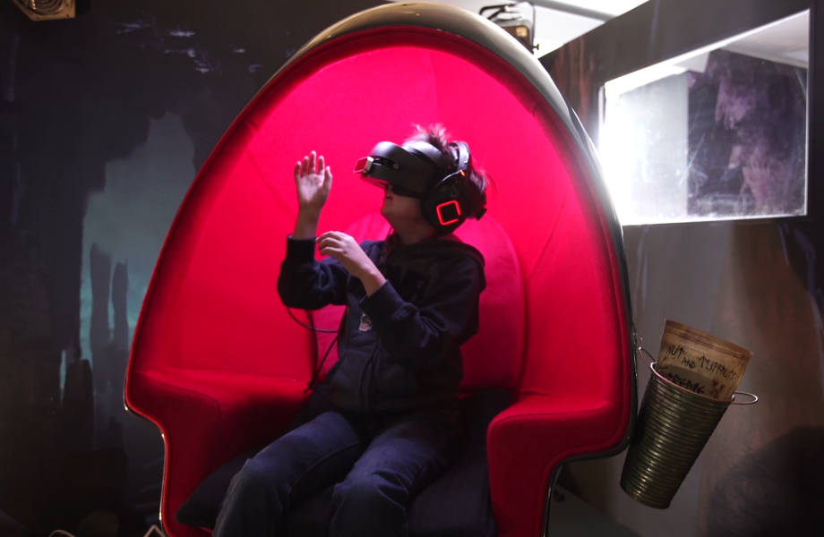 Young child using VR to experience the hidden world of How to Train Your Dragon