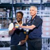 Greg Foran, President and CEO, Walmart U.S., promotes Tanaka Chikerema at Walmart Associate Meeting during Shareholders 2018