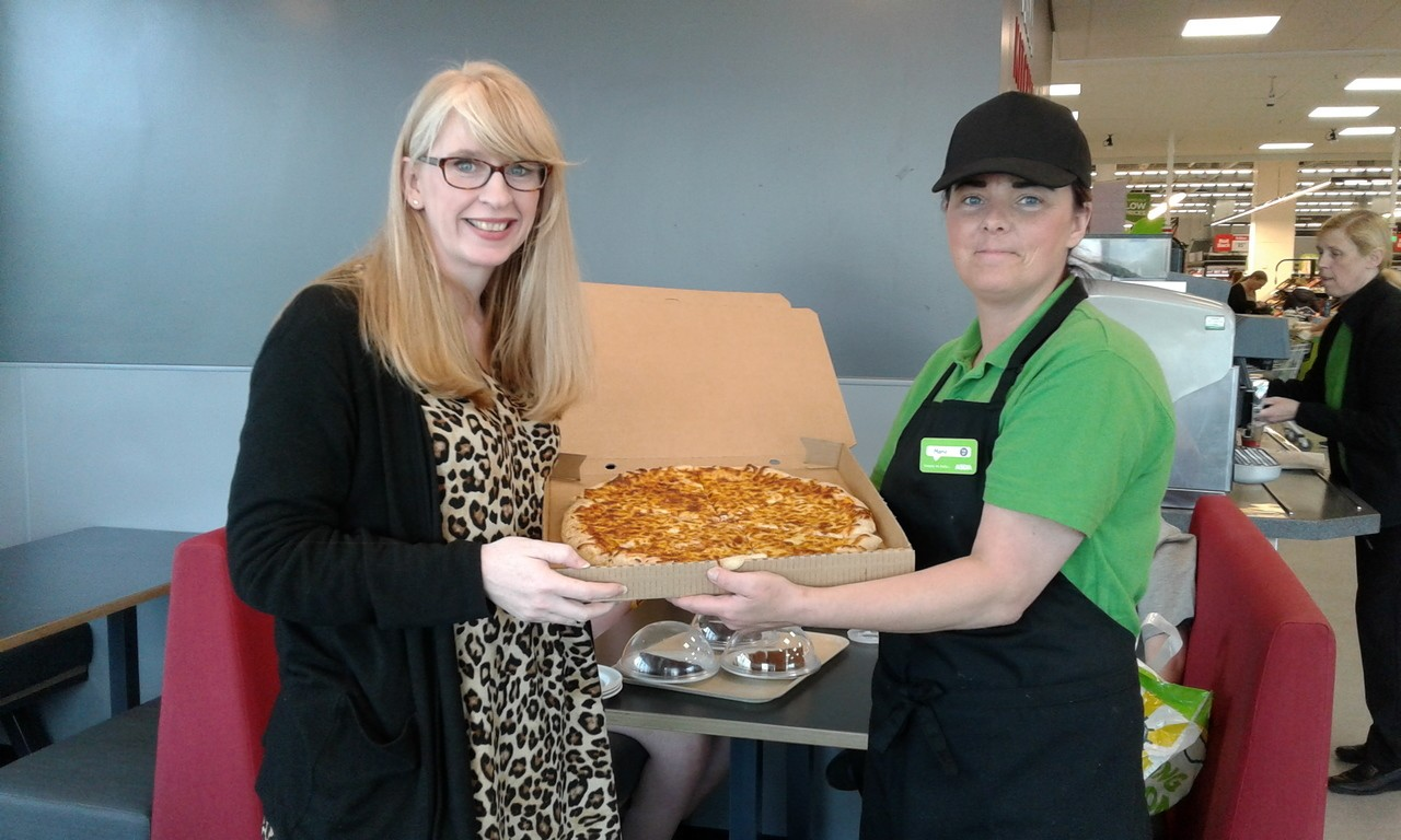 Our colleague Marie Doyle serving up some of our tasty hot pizza.