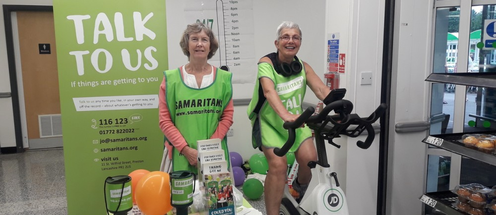 Volunteers cycling in store