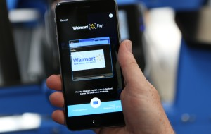 A customer has the Walmart Pay app open at the register