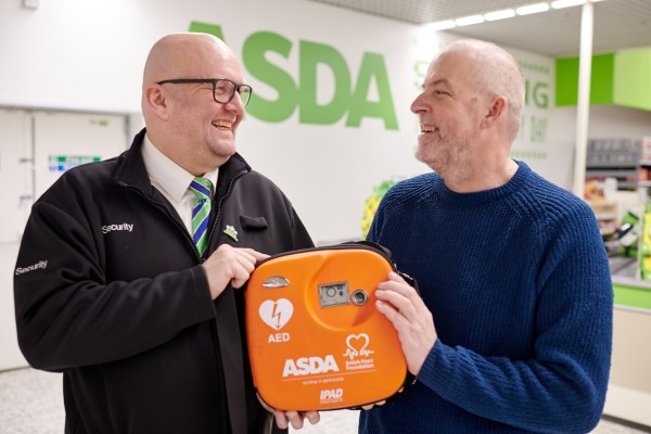 Asda customer Mark Isaac and security colleague Kim Peterson with the life-saving defibrillator