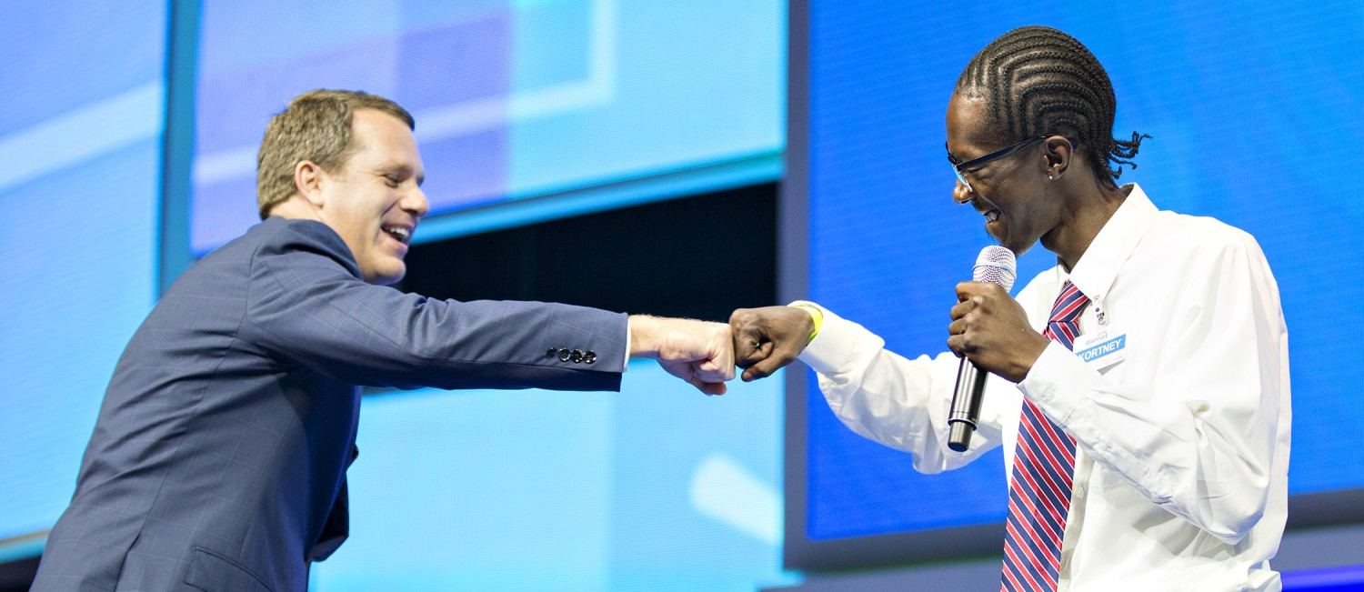 "CEO Doug McMillon shares a ""fist bump"" with Kortney Wright"