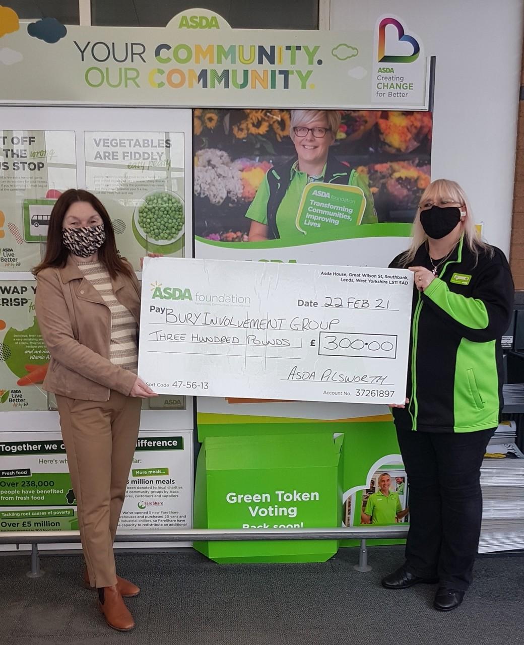 £300 cheque to Bury Involvement Group | Asda Pilsworth