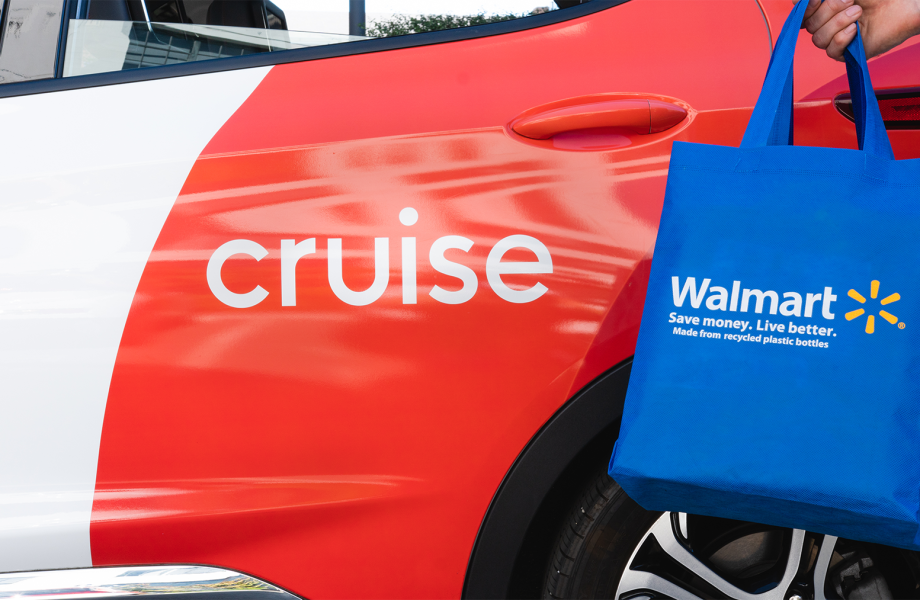 Self-driving car being loaded with Walmart bag