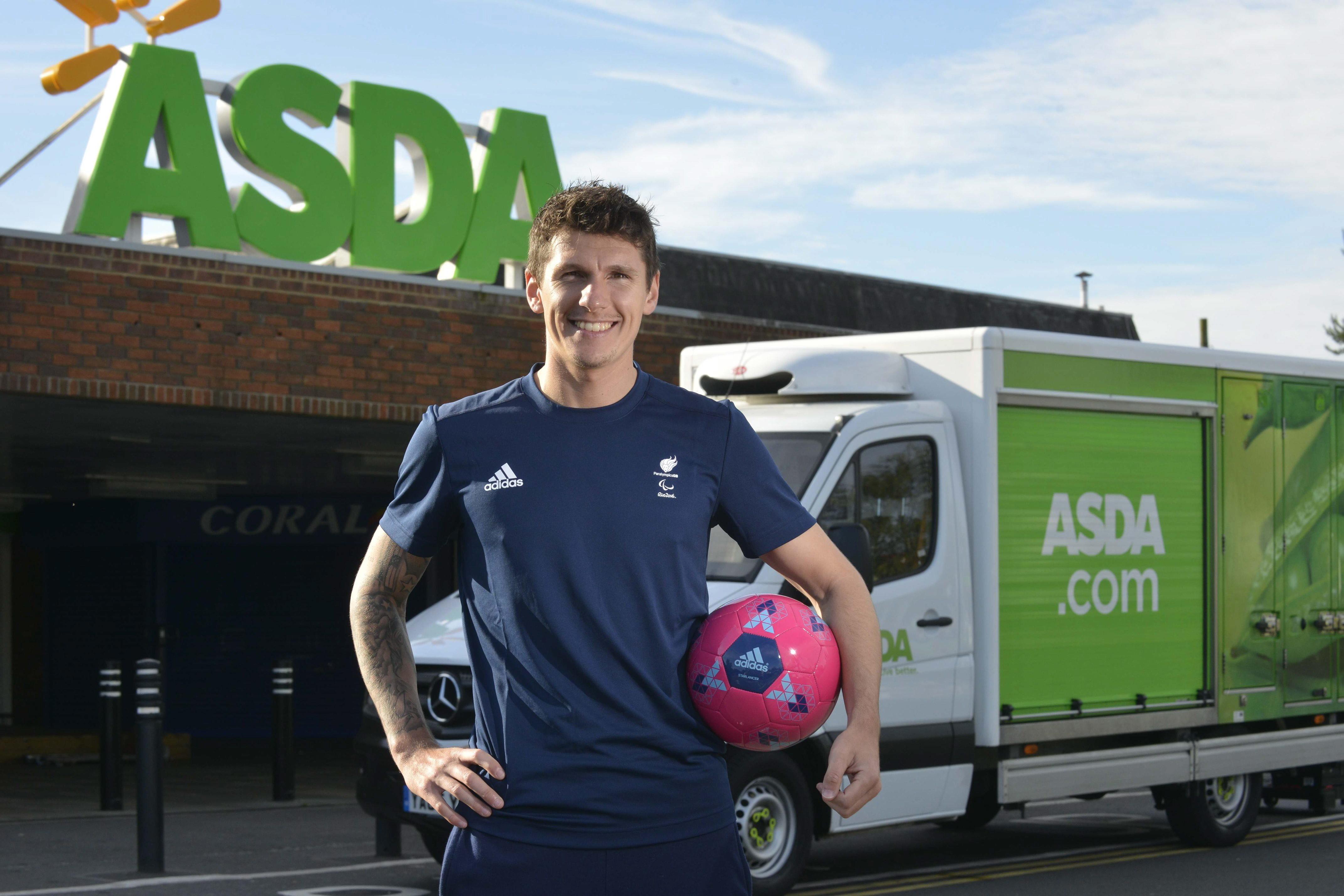 Asda Associate Matt Crossen standing in front of Asda and the ASDA.com truck