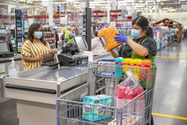 Sam's Club Member and Associate wearing masks at checkout