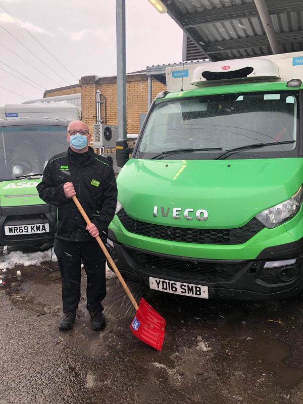 Shaun Dickson with snow shovel at the ready