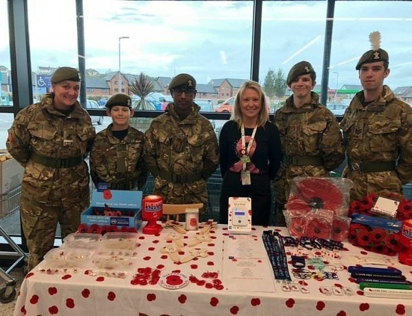 Cadets from AFC Barry sell poppies in Asda Barry