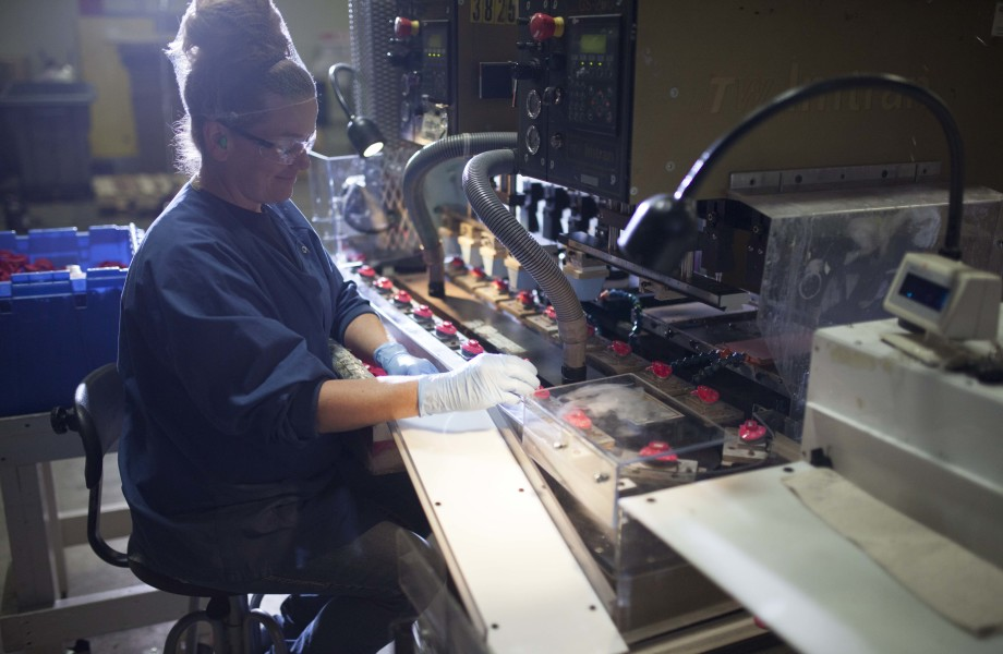 A woman is working in a factory