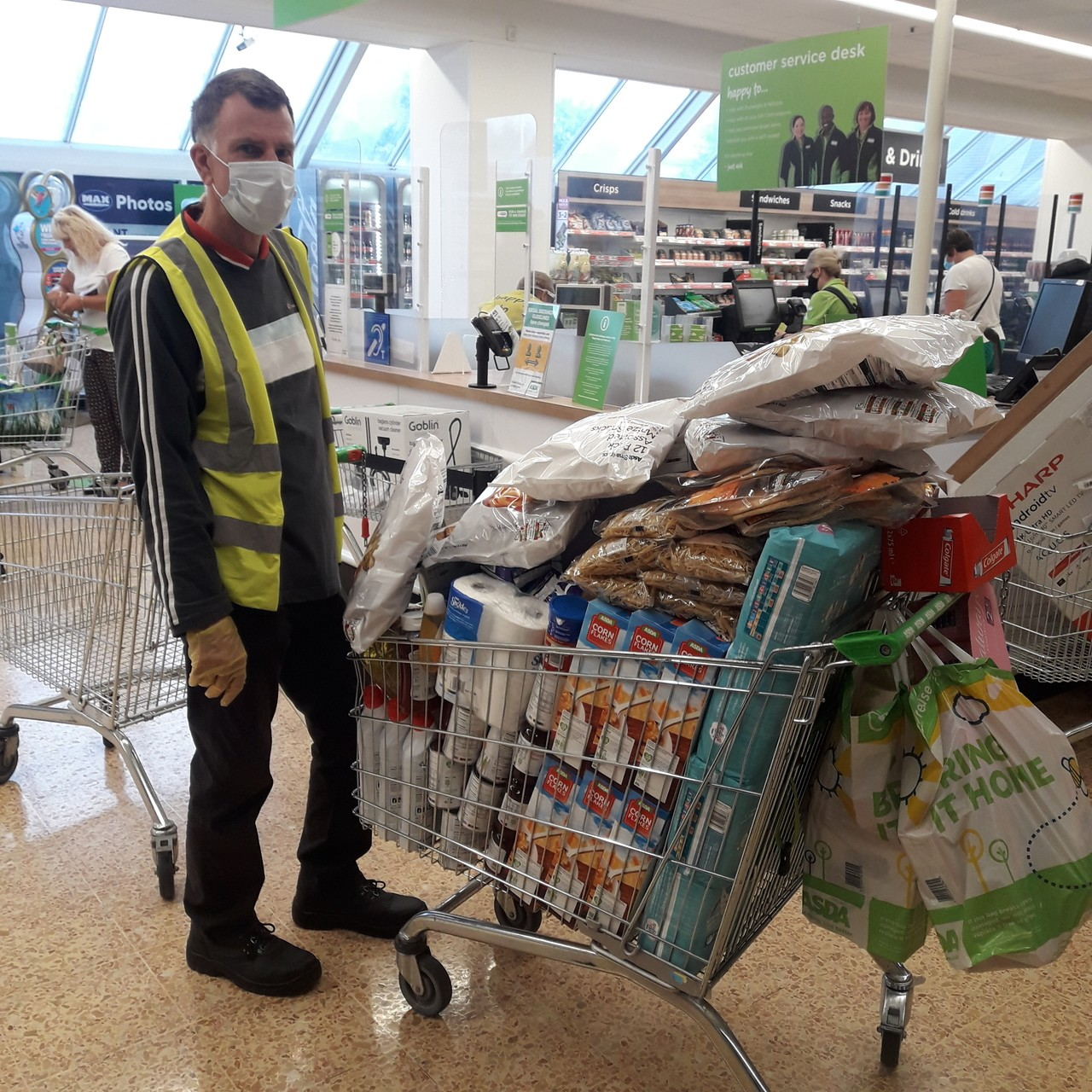 Donation to St Paul's Pantry food bank at St Paul's Centre | Asda Crewe