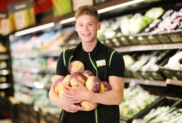 Asda colleague with swedes