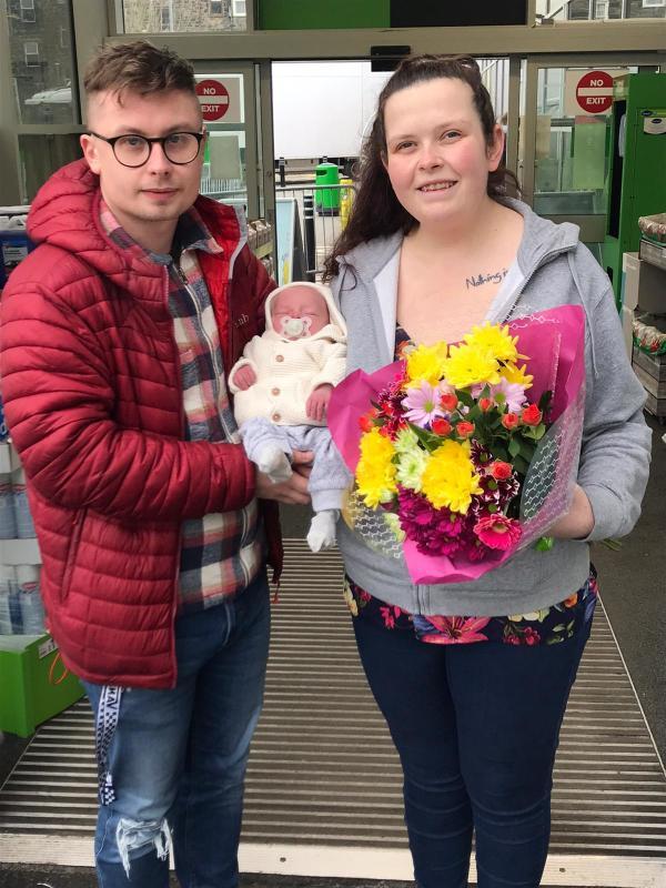 Dean Stawman and Delyth Jones with baby Harry who was born in the Asda Pwllheli car park