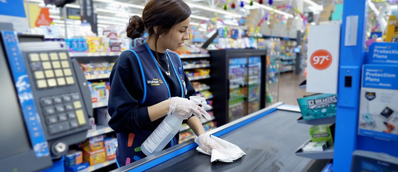 Associate Cleaning Checkout Counter Belt