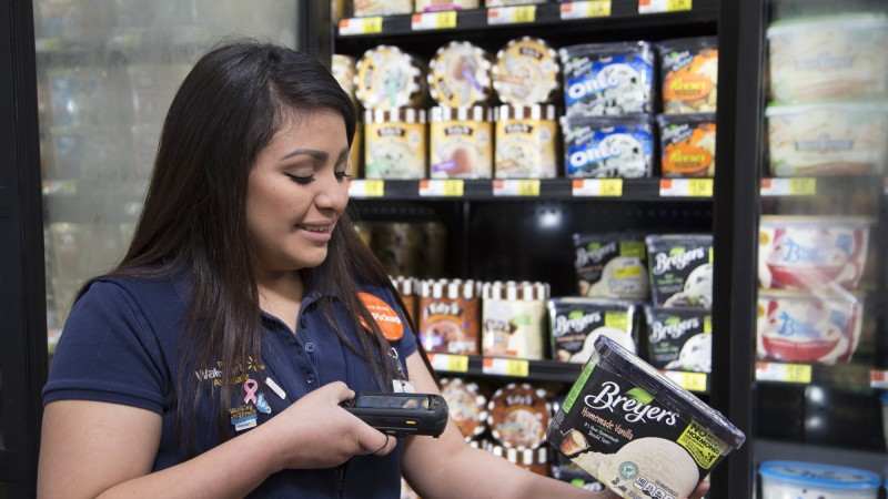 an associate scans ice cream for grocery pickup