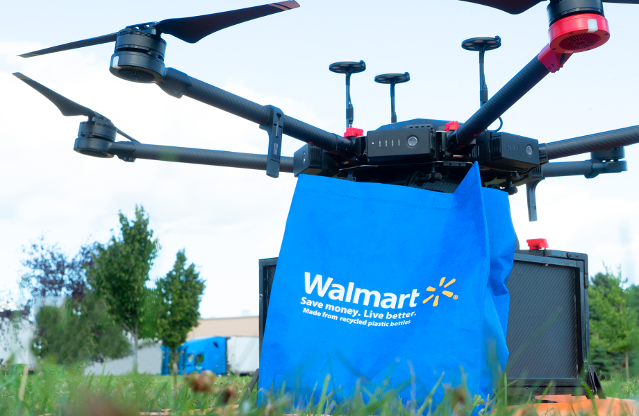 Drone with Walmart bag on grass