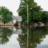 A street and house are flooded after a natural disaster