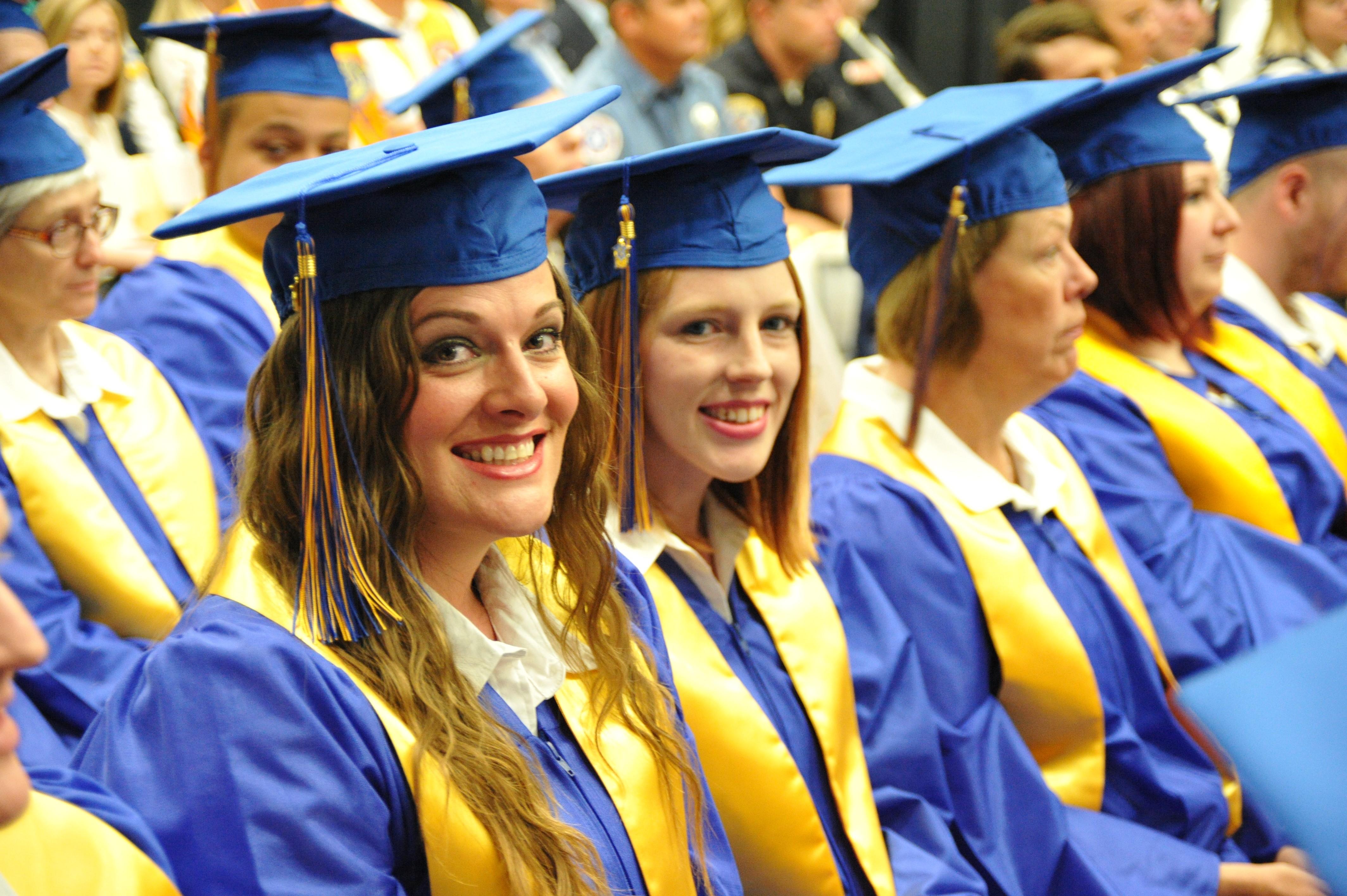 Two Walmart Academy graduates smiling