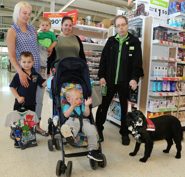 Asda Biggleswade colleague Russell and dog Ben with customers