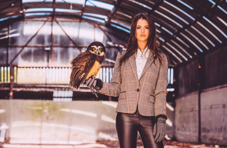Woman holding an owl whilst modelling the new George fashion range for Belfast Fashion Week