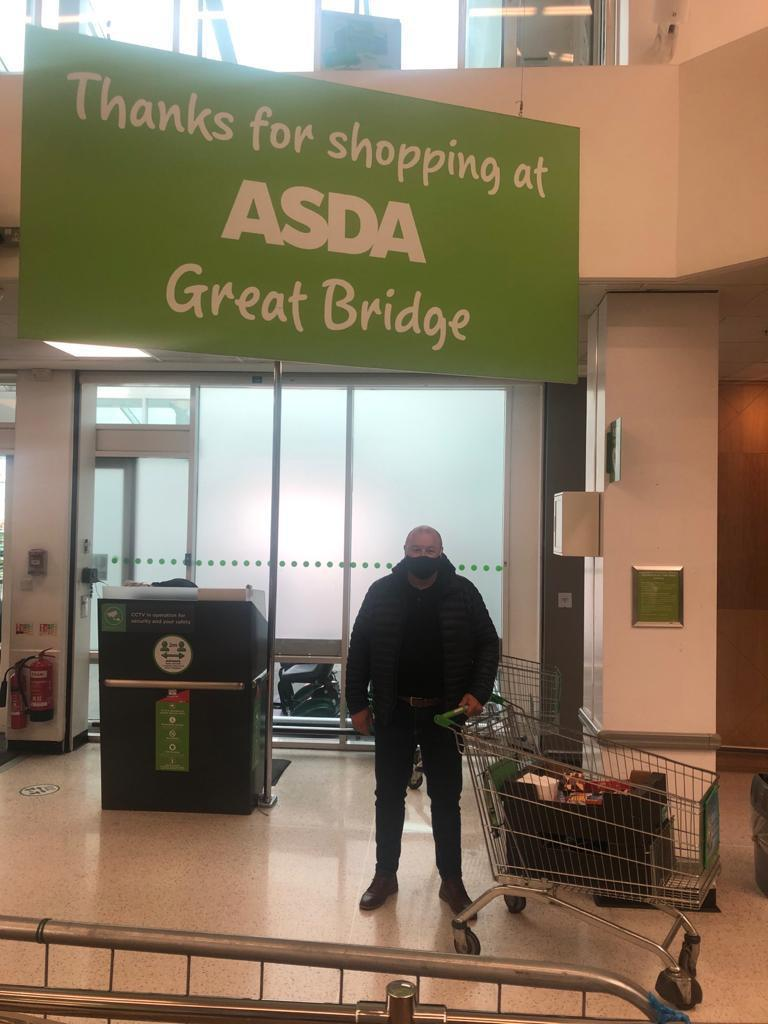 Gary from The Kaleidoscope plus Group collecting donations for their monthly raffles.  | Asda Great Bridge