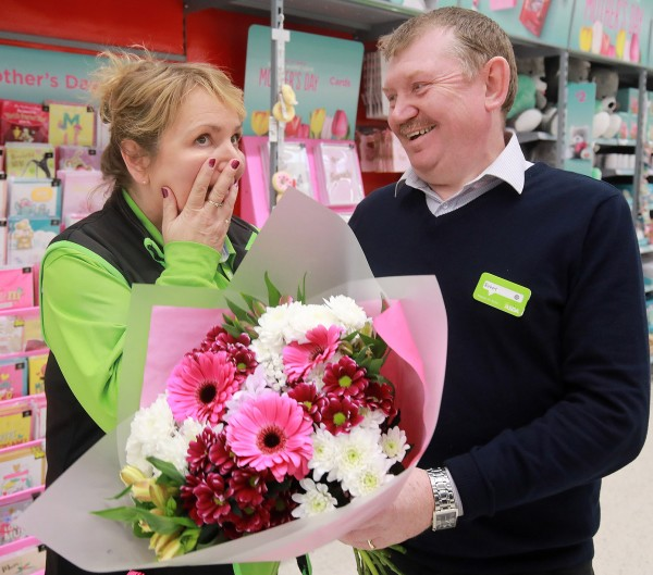 Asda Larne general store manager Robert Ryans presents Karen Smyth with flowers for Mother's Day
