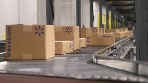 Walmart e-commerce fulfillment center boxes being shipped