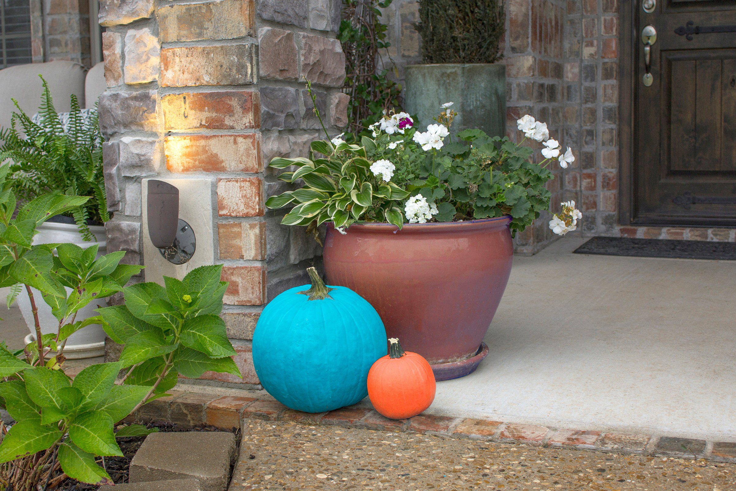 A teal pumpkin sits outside a house to symbolize Halloween food allergy awareness