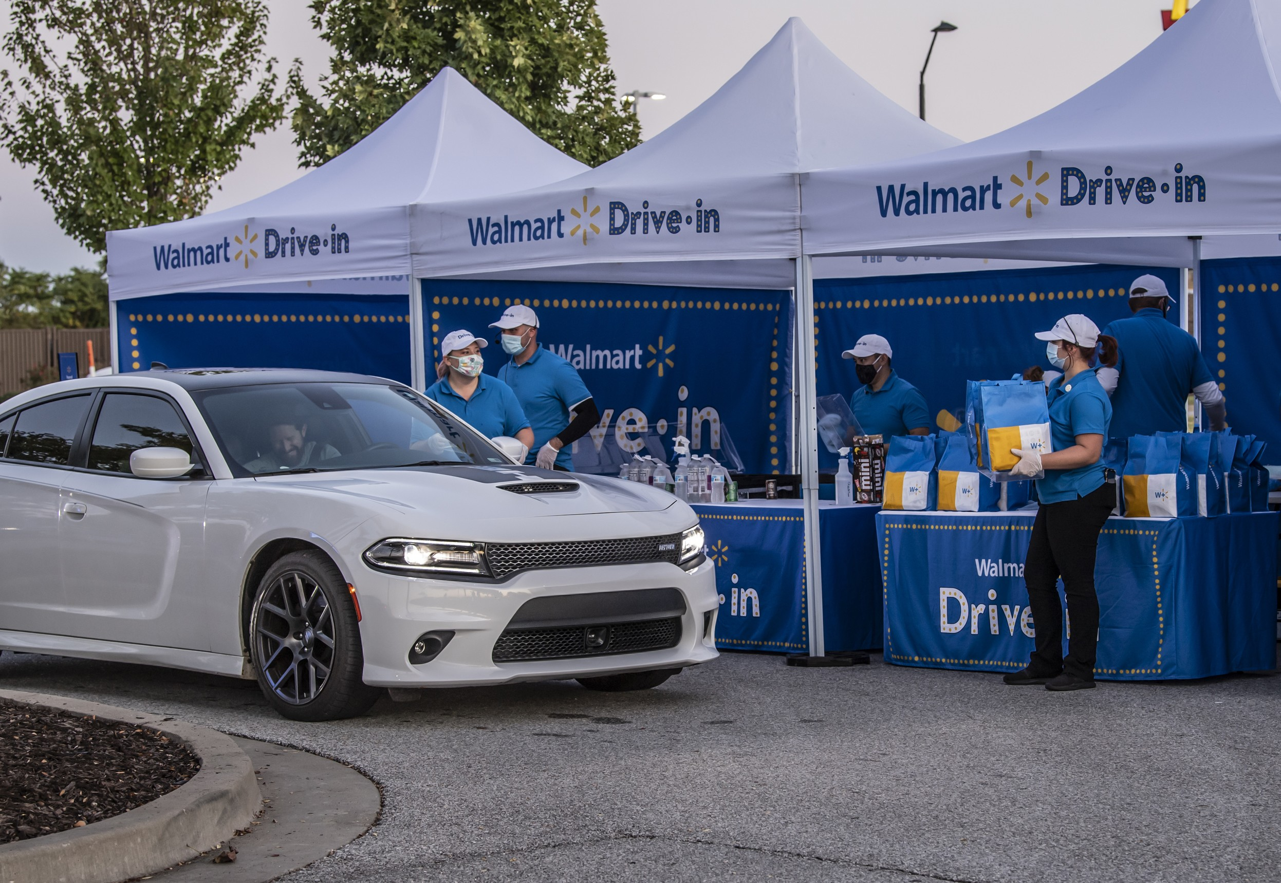 Walmart Drive-In associates passing out welcome bags