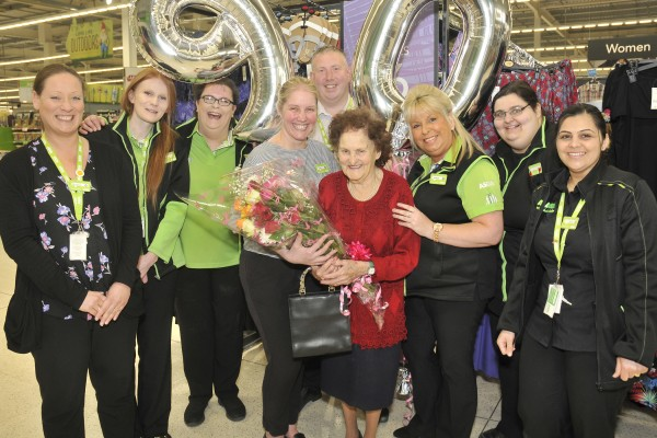 Asda Rushden customer Olive Lovell celebrating her 90th birthday with colleagues