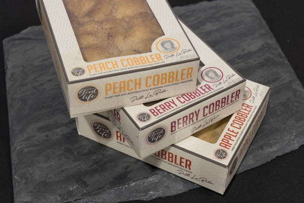 A stack of boxes with cobblers inside