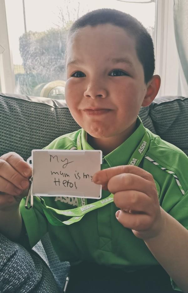 Oliver Neilson dresses in Asda uniform for school superhero day