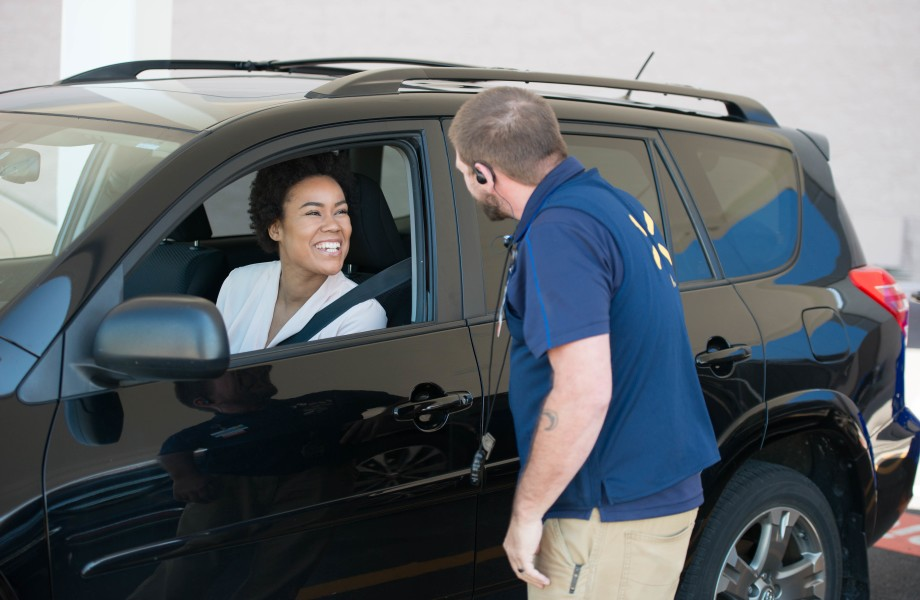 A female customer interacting with a male associate at Pickup