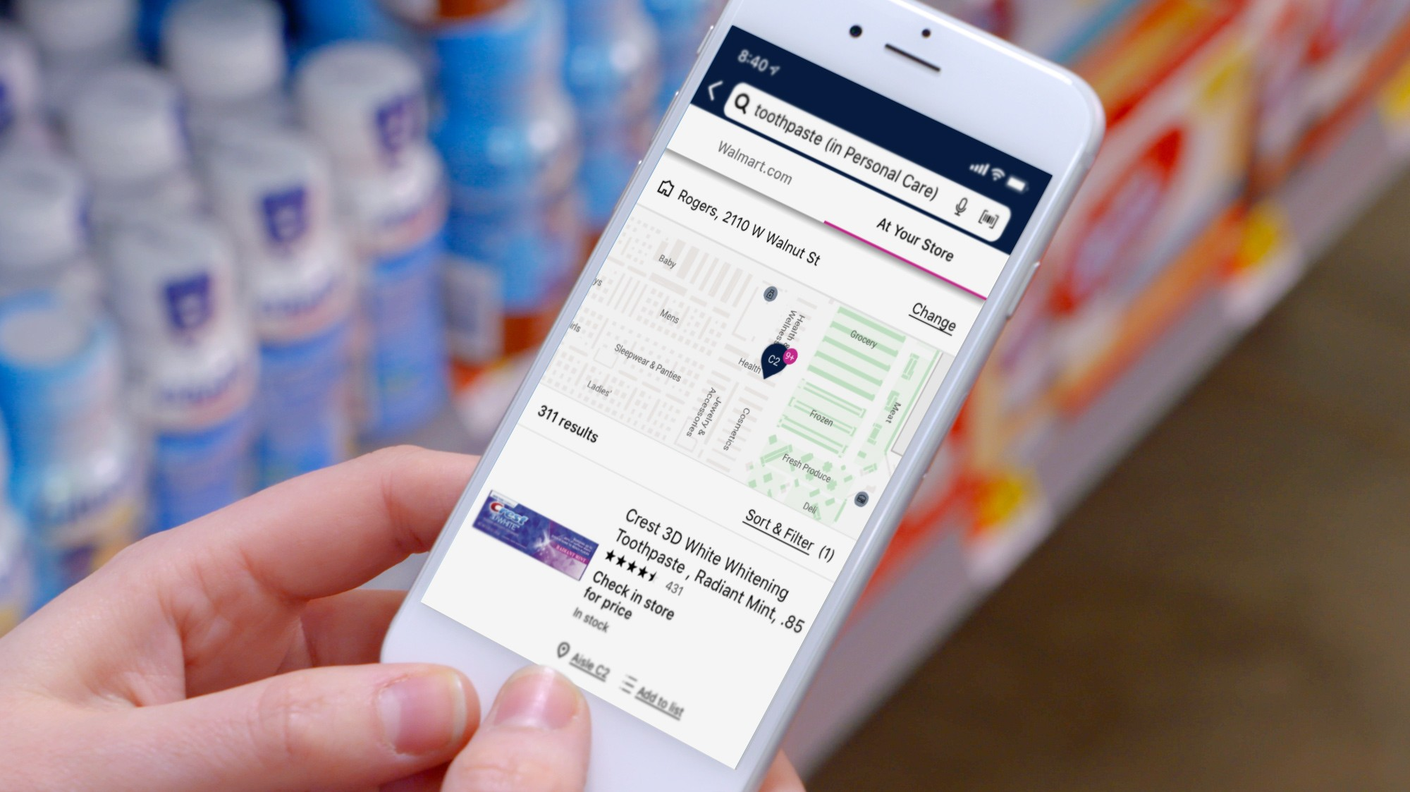 A customer uses the everyday maps feature in the Walmart app to find toothpaste