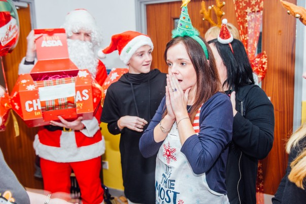 Elizabeth Williams from Canolfan Pentre receiving a £10,000 Christmas surprise from Asda