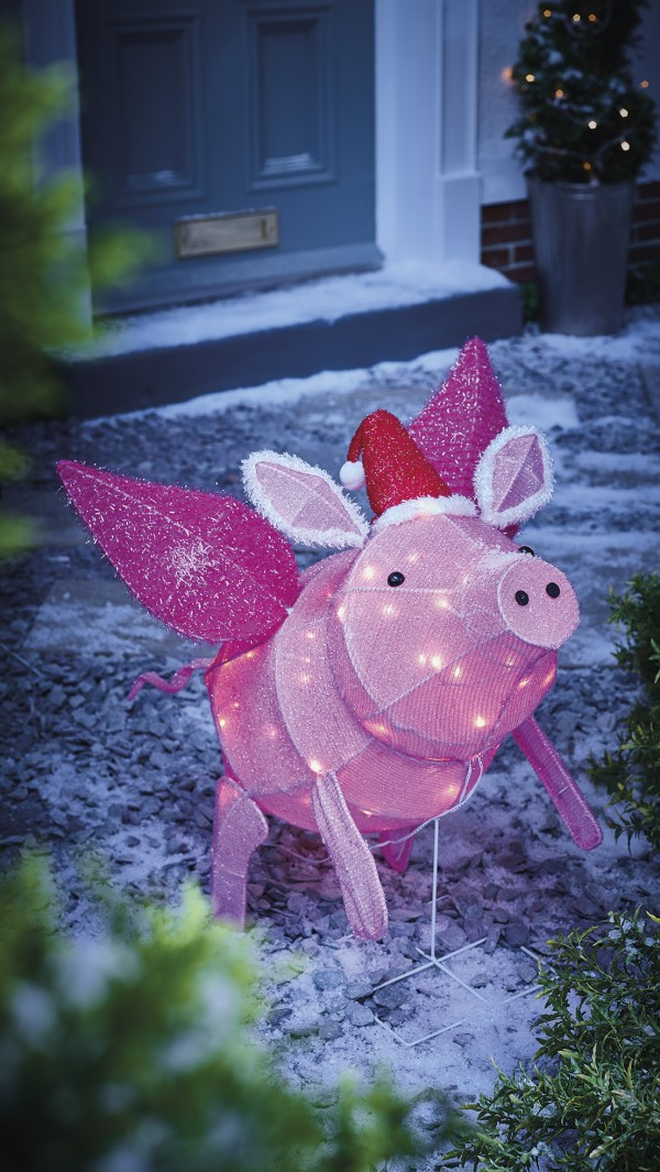 Flying pig light outdoors