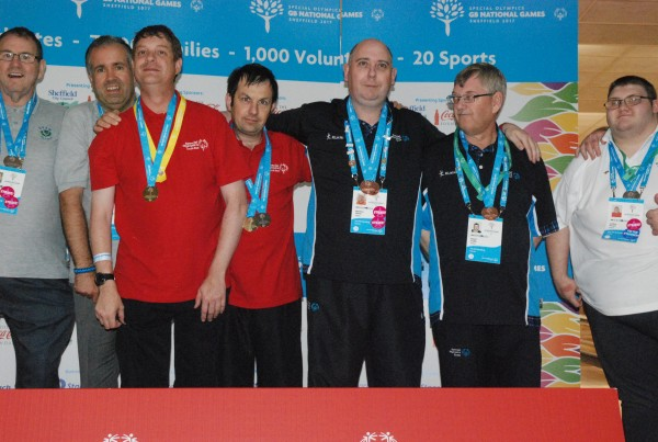 Asda colleague Matthew White with fellow ten pin bowling medalists at the Great Britain Special Olympics