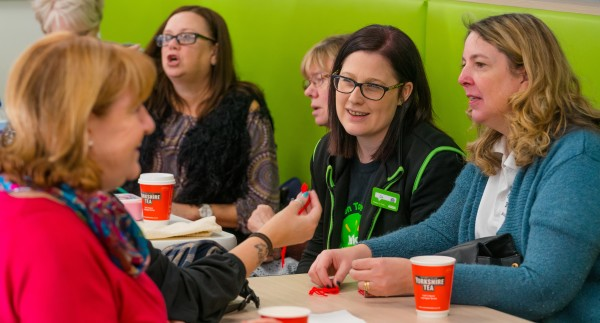 Asda Warrington community champion Liz Cotterill chats to guests at the community friendship meeting