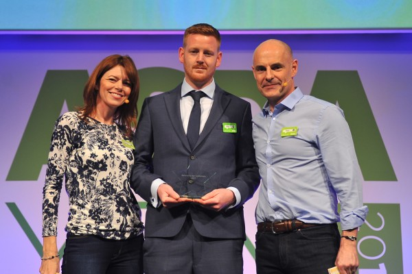 Aston Olver receives his Service Colleague of the Year award from Roger Burnley and Hayley Tatum