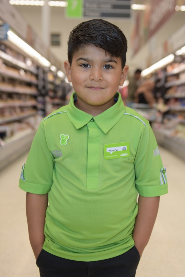 Four-year-old Huzaifah Ahmed in his Asda uniform