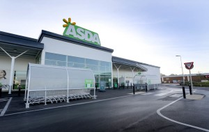 The exterior of an Asda at sunset