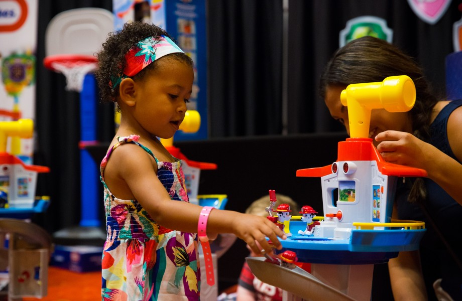 A child checks out one of the hot new toys on display at the Top Rated by Kids event hosted by Walmart for the 2017 Christmas shopping season.